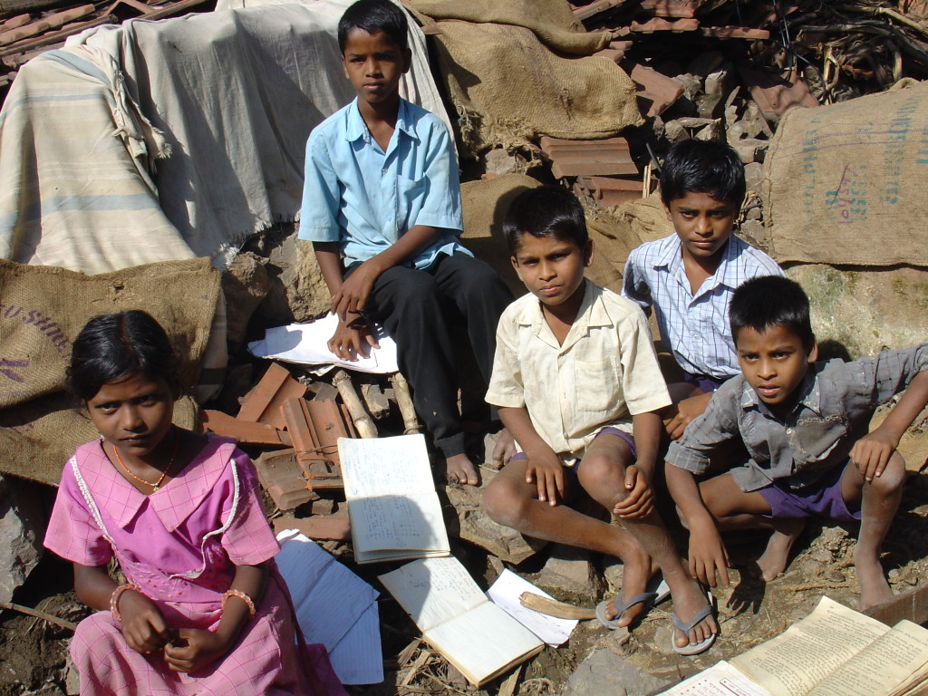 Preparing communities and building resilience are key to stop disasters from becoming crisis--Children drying books damaged by flood waters in Karnataka, India- Unni Krishnan (August 2005)