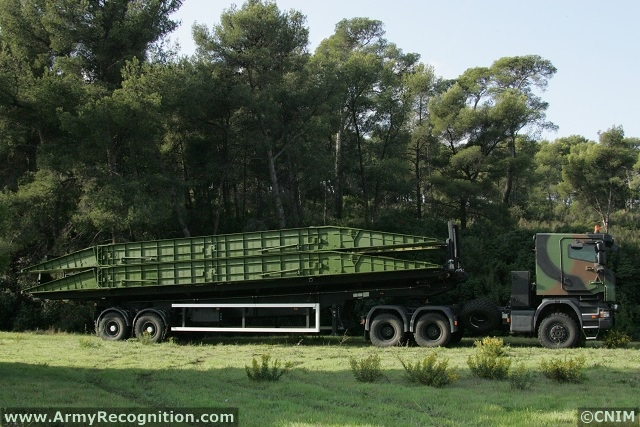 One semi-trailer of one tractor with 3 axles Scania 6x6 (PTS in the French Army) and one trailer adapted for the transport of 2 additional bridge sections, which allows supplying the launcher. Launching and retrieving of the bridge is operated under protection by a crew of 2 from the armored cabin of the launcher.
