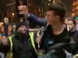 The clip filmed outside Manchester's Factory nightclub in the early hours of Sunday shows security staff punching two men