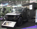 United Kingdom, London. At DSEI 2013, Renault Trucks Defense showcases its The Sherpa Light APC « XL »; Used for deploying a team of 10 officers into a hostile situation or establishing an armored mobile command center. It is also able to receive any mission or weapon system thanks to a large internal volume.