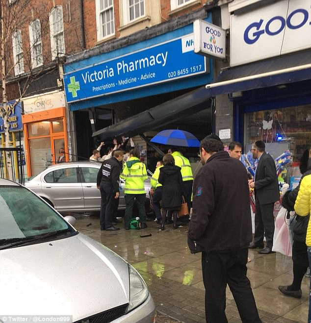 Two people have been injured after a car ploughed into a shop in Golders Green, London