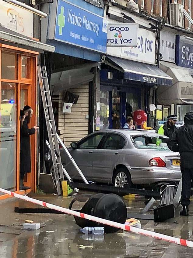 One person was believed to be trapped underneath the car following the smash