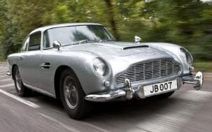 "May0026381 007 Aston Martin for DT Motoring...May0026381 007 Aston Martin for DT Motoring. The Aston Martin DB5 driven by Sean Connery as James Bond in ""Goldfinger"" and ""Thunderball"" is going on sale at a London auction in October. The silver 1964 Aston Martin DB5 has bullet proof plate, fake machine guns and revolving number plates. Picture shows the car being driven by Andrew English through the Surrey countryside. Picture date 14/10/2010"