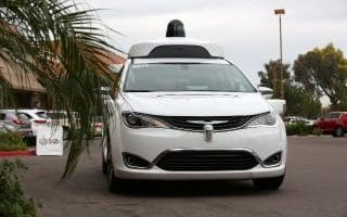 A Waymo Chrysler Pacifica Hybrid self-driving vehicle approaches during a demonstration in Chandler, Arizona