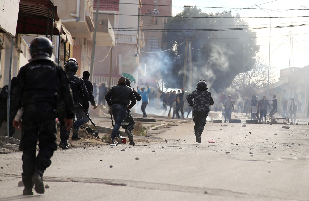 Riot police clash with protesters during demonstrations in Kasserine, Tunisia on Tuesday.