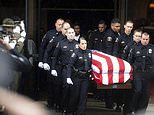 """Newman police officers carry the body of their slain colleague Cpl. Ronil """"Ron"""" Singh during his funeral on Saturday, Jan. 5, 2019, in Modesto, Calif. According to authorities, prosecutors have charged Gustavo Perez Arriaga, who was in the United States illegally, with Singh's killing. (AP Photo/Noah Berger)"""