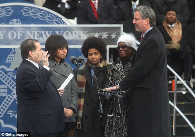 Official: Bill de Blasio takes the oath of office administered by US Congressman Jerrold Nadler (left) accompanied by his daughter Chiara (second left), son Dante (center) and wife Chirlane in 2010