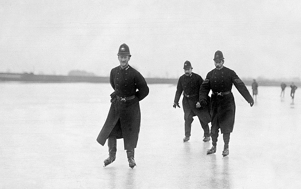 London policemen on ice skates on the frozen River Thames circa 1900