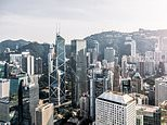 China will overtake the United States as the world's largest economy in a decade's time while India will assume second place, according to a British financial services firm. The above image is a stock photo of Hong Kong