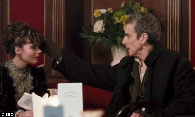 Capaldi then reaches over and pulls out a strand from his co-stars head as she exclaims in pain