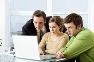 Three people in office setting