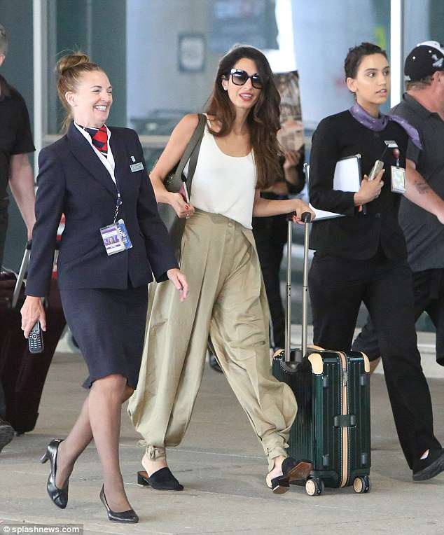 Commanding attention: The Human Rights lawyer, 40, put on a typically chic display as she slipped her slender figure into a pair of stone-coloured harem trousers