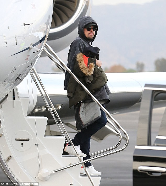 Low-key: The Oscar-winning actor, 43, attempted to go under the radar in a hoodie, baseball cap and dark glasses as he disembarked a private jet