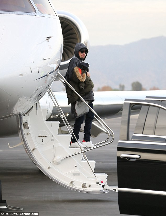 Air miles: Environmentalist DiCaprio's lavish mode of transport to get him back from his winter vacation in the upmarket ski resort will no doubt raise eyebrows