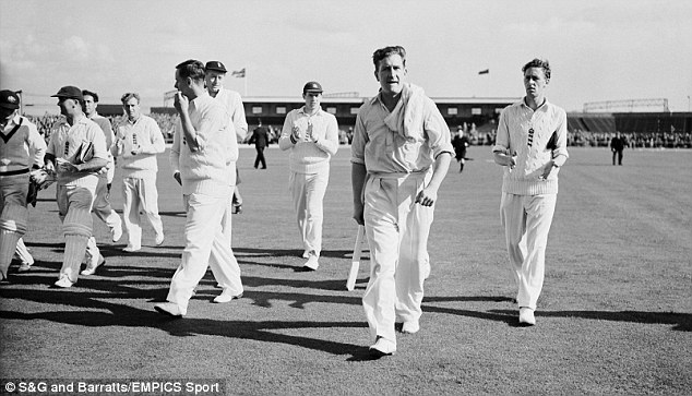 History: Jim Laker (front) got his ten-wicket haul against Australia at Old Trafford