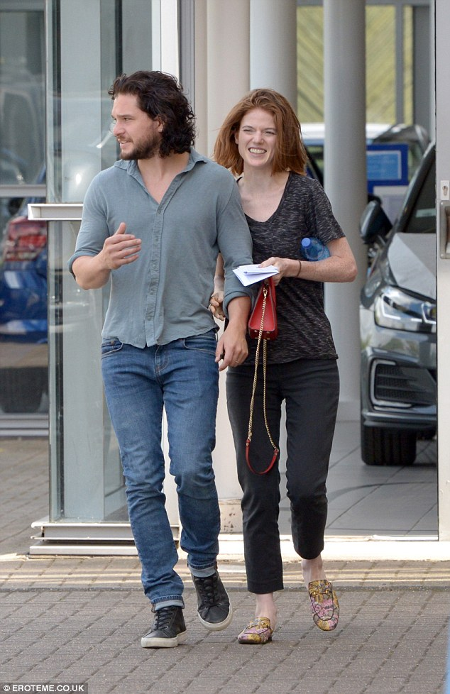 Smitten: Settling into the humdrum of married life, the Game Of Thrones actor, 31, packed on the PDA with Rose, 31, as they looked for their new automobile