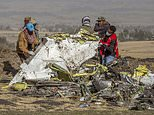 FILE - In this March 11, 2019, file photo, rescuers work at the scene of an Ethiopian Airlines flight crash near Bishoftu, Ethiopia. A published report says pilots of an Ethiopian airliner that crashed followed Boeing¿s emergency steps for dealing with a sudden nose-down turn but couldn¿t regain control. (AP Photo/Mulugeta Ayene, File)