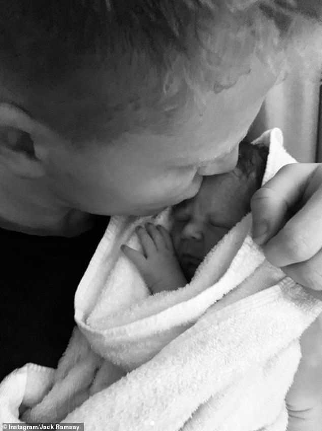 Loved:Jack was a proud older brother as he cradled newborn Oscar and planted a sweet kiss on his head in two adorable photos
