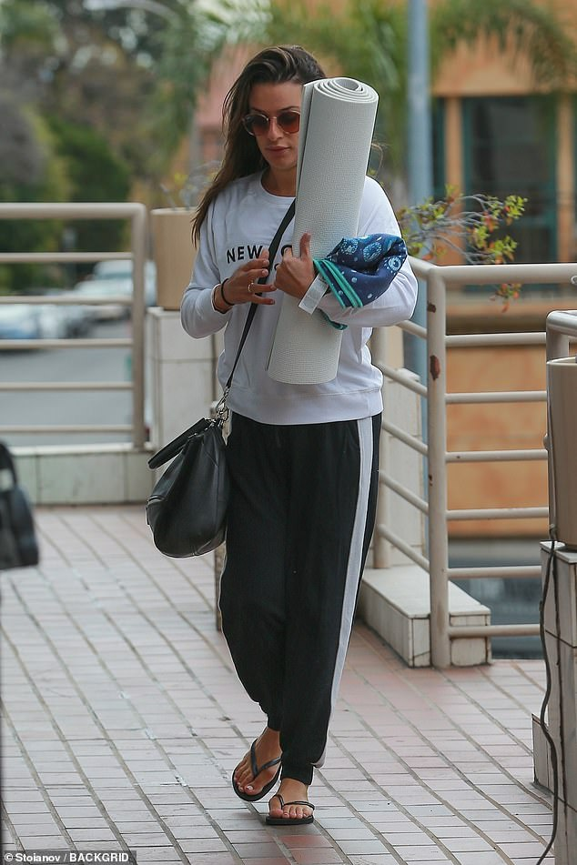 Stomp:On her way to the workout, Lea rocked a white New York sweatshirt as she stomped the streets in flip flops