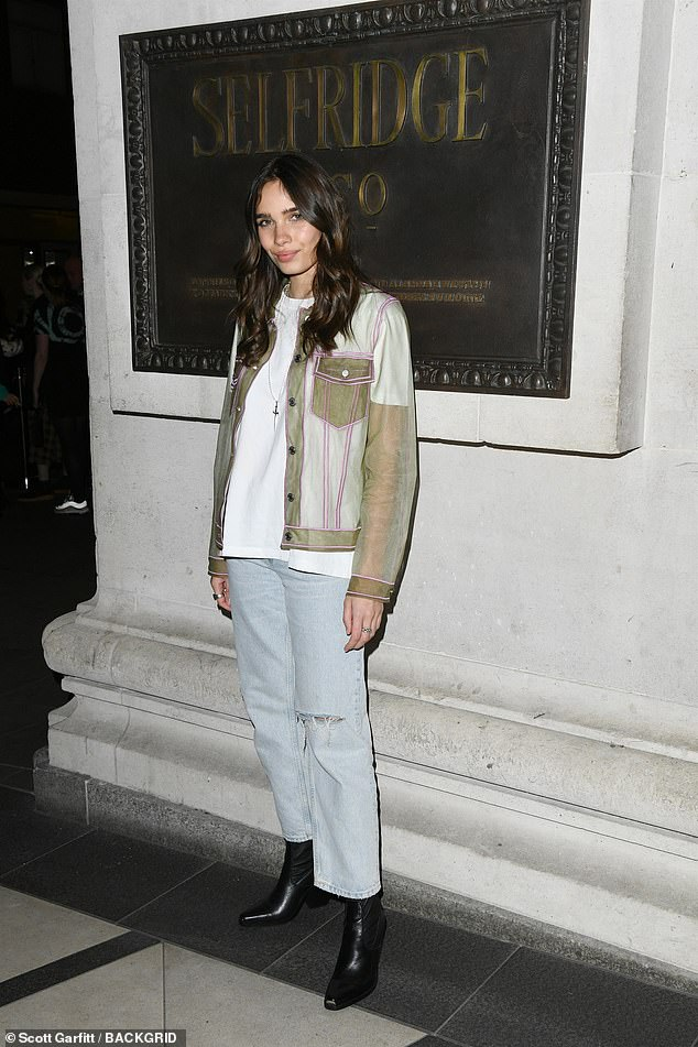 Cute chic:Hana was equally cool in her quirky ensemble as she dressed in a see-through jacket and distressed jeans for the event