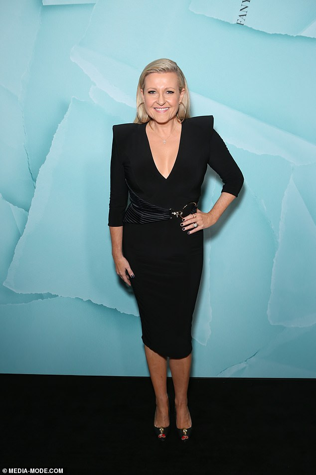 Sticking to the classics! Australian journalist Angela Bishop (pictured) wore a plunging black dress for the event