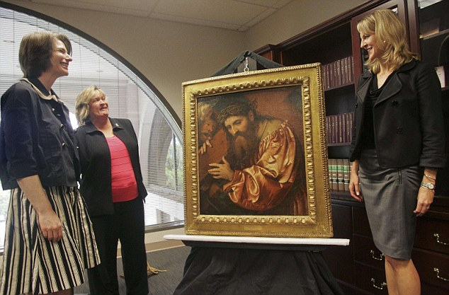 Law enforcement officials in Tallahassee pose with 'Christ Carrying the Cross Dragged by a Rogue' after returning the painting to the family of Federico Gentili di Giuseppe
