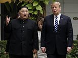 FILE - In this Thursday, Feb. 28, 2019, file photo, President Donald Trump and North Korean leader Kim Jong Un take a walk after their first meeting at the Sofitel Legend Metropole Hanoi hotel, in Hanoi. Kim says he's open to having a third summit with Trump if the United States could offer mutually-acceptable terms for an agreement by the end of the year. (AP Photo/Evan Vucci, File)