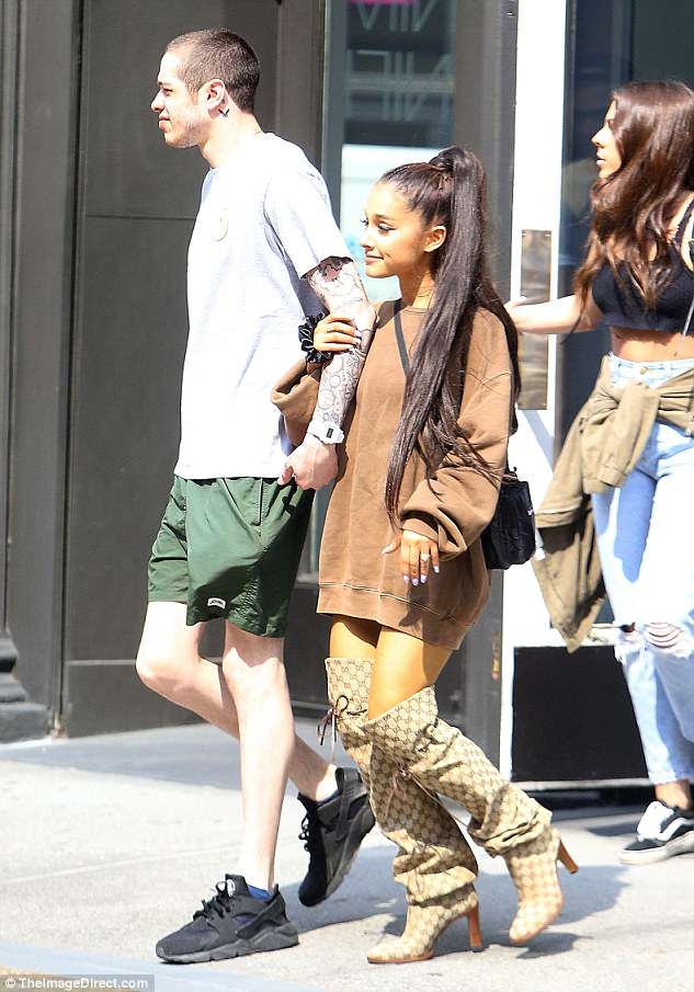 Strutting her style!She gave a flash of her toned legs and completed her look with $1800 Gucci boots