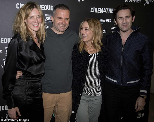 Good times: The French actress and singer looked happy alongside Kate Moran (L) and French film director Yann Gonzalez as well as actor Nicolas Maur