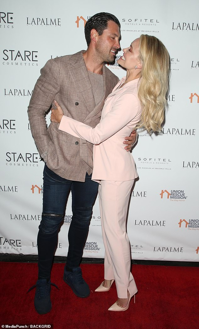 Wedded bliss: Maksim Chmerkovskiy and Peta Murgatroyd couldn't hide their feelings for one another as they arrived at a party hosted by LaPalme Magazine in LA on Tuesday night