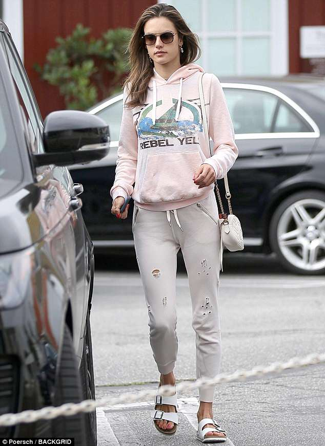 Relaxed: The supermodel was casually dressed in a soft pink hoodie and tattered  n:PHILANTHROPY joggers