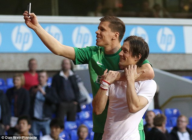 Say cheese: Szczesny wasn't done there, and collared goalscorer Tomas Rosicky for another photo