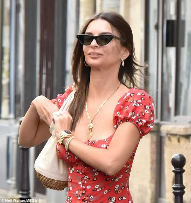 Sun-kissed: The I Feel Pretty actress toted a white canvas basket bag and wore black cat-eye sunglasses over her minimally made-up face