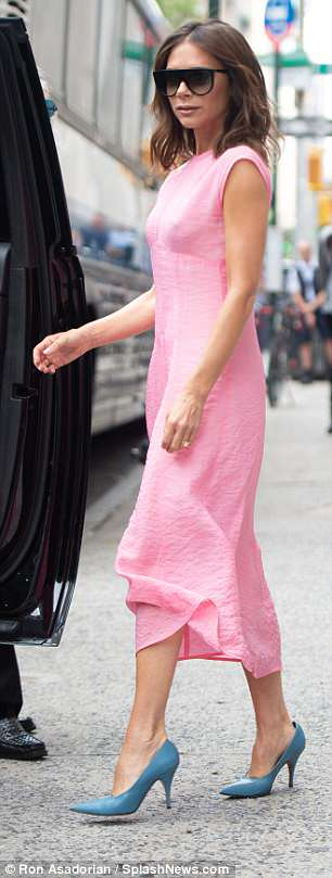 Fashion fiend: The designer put her best fashion foot forward in her envy-inducing midi dress