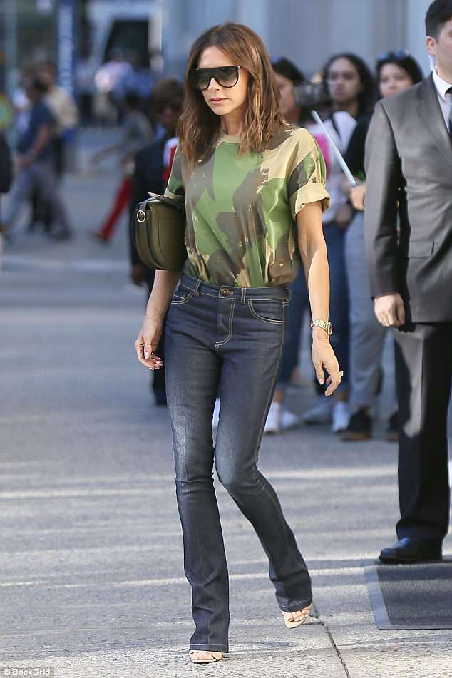 Casually cool: Making the most of the afternoon sun, the former songstress looked sensational in her casually cool top which was tucked into her tight jeans