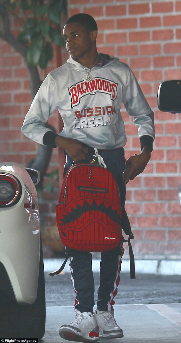 Style:The aspiring rap artist was seen in a $70 sweater which read 'Backwoods Russian Cream' - a cigar company