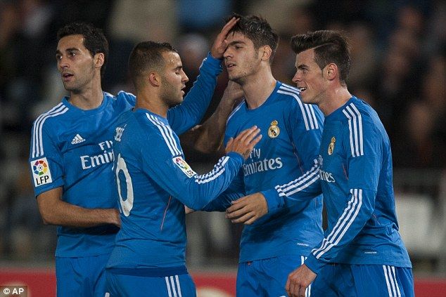 Fine company: Morata is congratulated by team-mates Alvaro Arbeloa, Jese and Gareth Bale