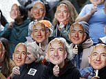 """FILE - In this Oct. 31, 2018, file photo, demonstrators hold images of Amazon CEO Jeff Bezos near their faces during a Halloween-themed protest at Amazon headquarters over the company's facial recognition system, """"Rekognition,"""" in Seattle. San Francisco is on track to become the first U.S. city to ban the use of facial recognition by police and other city agencies as the technology creeps increasingly into daily life. Studies have shown error rates in facial-analysis systems built by Amazon, IBM and Microsoft were far higher for darker-skinned women than lighter-skinned men. (AP Photo/Elaine Thompson, File)"""
