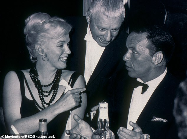 Marilyn Monroe with singer and actor Frank Sinatra, who she dated for several months in 1961