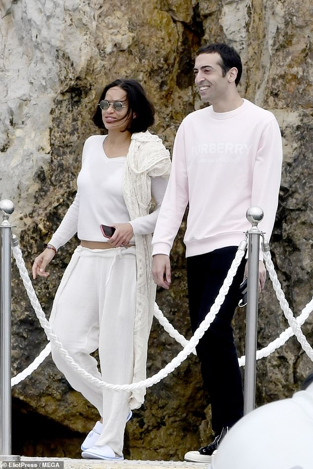 Handsome: Mohammed stepped out in a pink Burberry jumper and black trousers