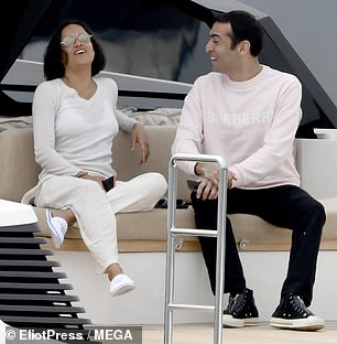 In good spirits: The pair chatted away and burst into giggles