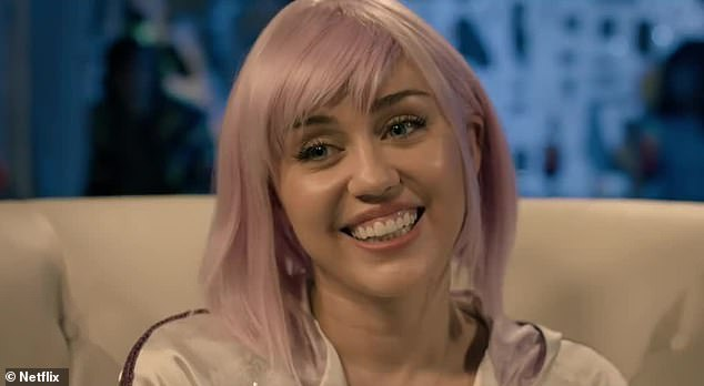 Making sure she's believable: Despite her mental illnesses, Ashley puts on a fake smile to promote her Alexa style doll