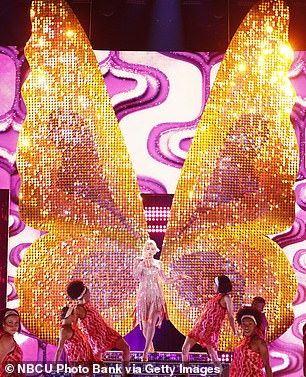 Big wings: Taylor had giant butterfly wings behind her as she started her performance