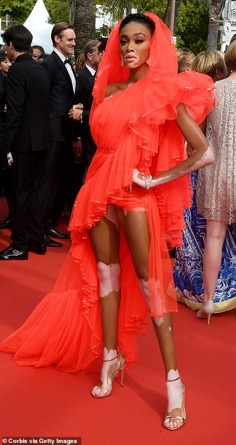 Standing tall: The Canadian-born beauty upped the style ante as she boosted her frame in a pair of silver strappy heels