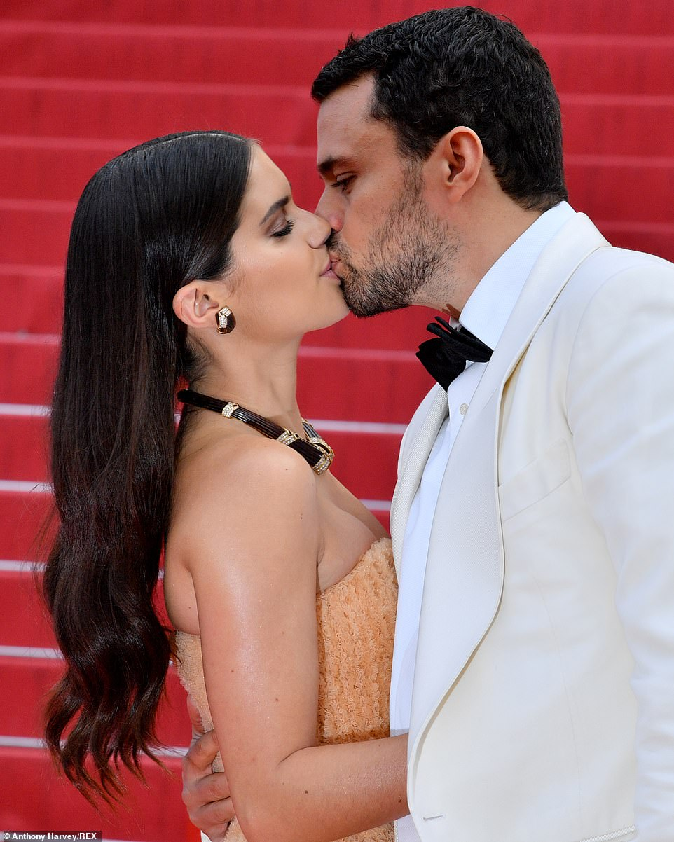 Lovebirds: The star had her own fairytale moment as she shared a tender kiss with boyfriend Oliver Ripley on the red carpet