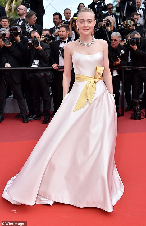 Stunning: Dakota Fanning stunned in a rose pink gown as she also arrived for the lavish event
