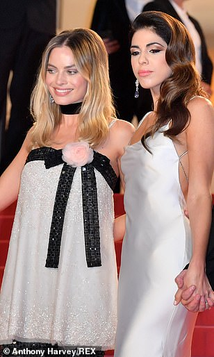 Eclectic: But Margot still managed to add a modern twist to her red carpet outfit, which was a far cry from the usual gowns sported by other stars