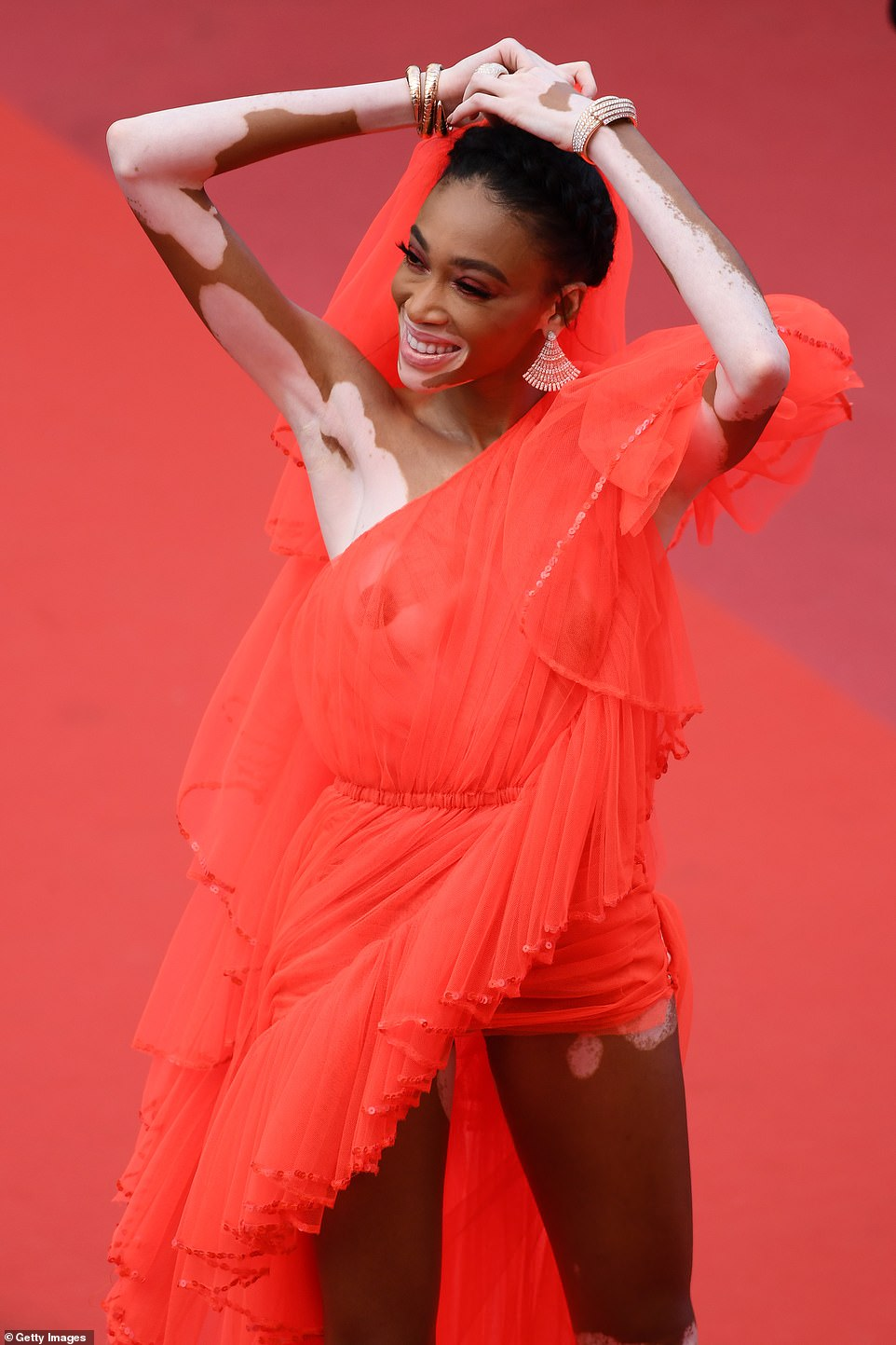 Beaming: Winnie appeared in great spirits as she displayed her modelling prowess at the star-studded premiere