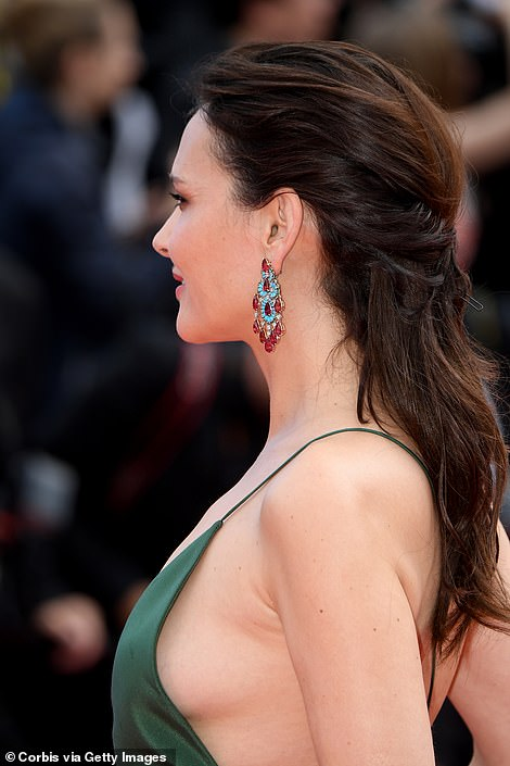 Dazzling: The star's jewellery of choice was encrusted with dazzling blue and red gem stones