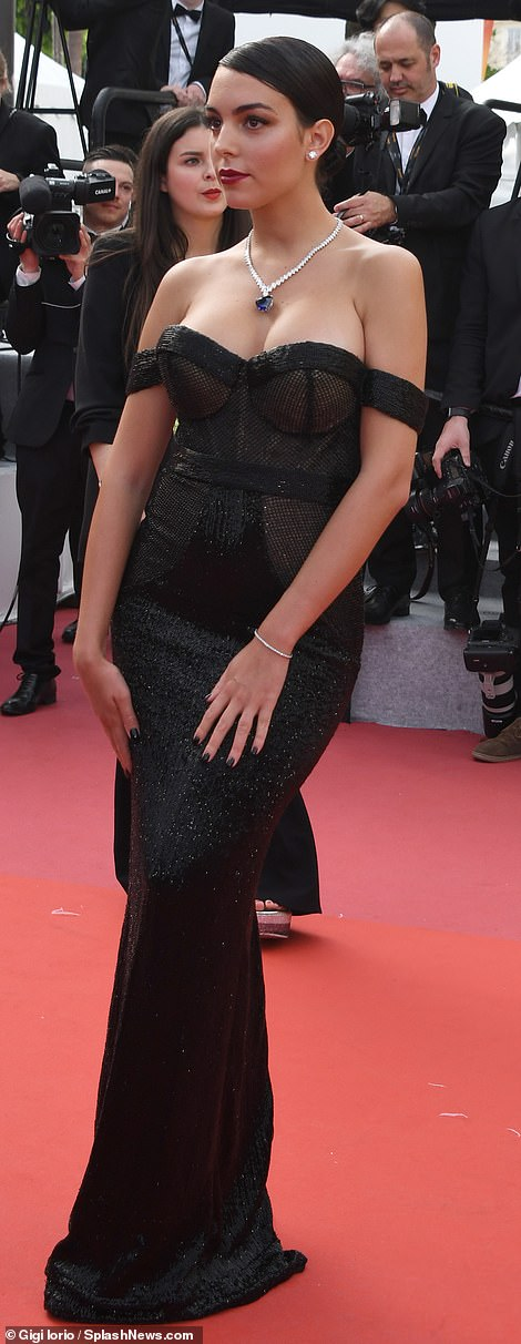 Vamp it up: The Spanish accentuated her ample cleavage through the gown's mesh panels